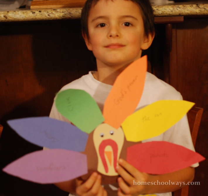 Boy with Thanksgiving turkey craft