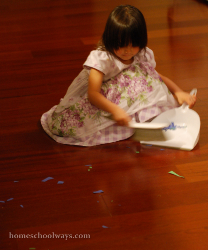 Little girl sweeps the floor