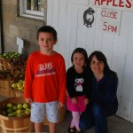 Mom and children at apple orchard