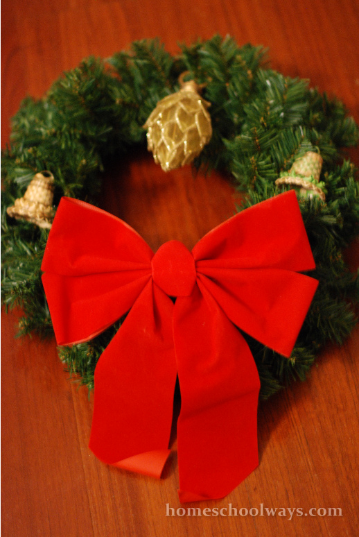 I bought a simple wreath at the Christmas Store in Pigeon Forge and added things we already had - a bow, a couple of bells and an ornament