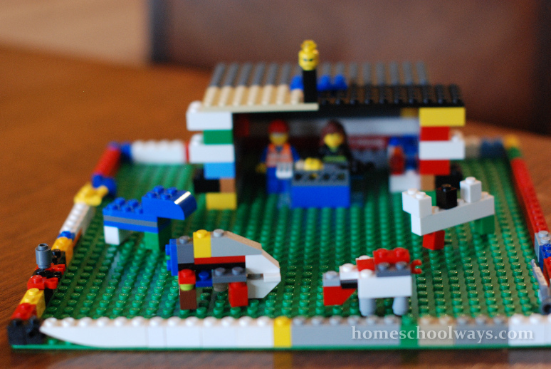 LEGO nativity scene - baby Jesus, Joseph, Mary, grazing sheep, a donkey, a camel, and an angel
