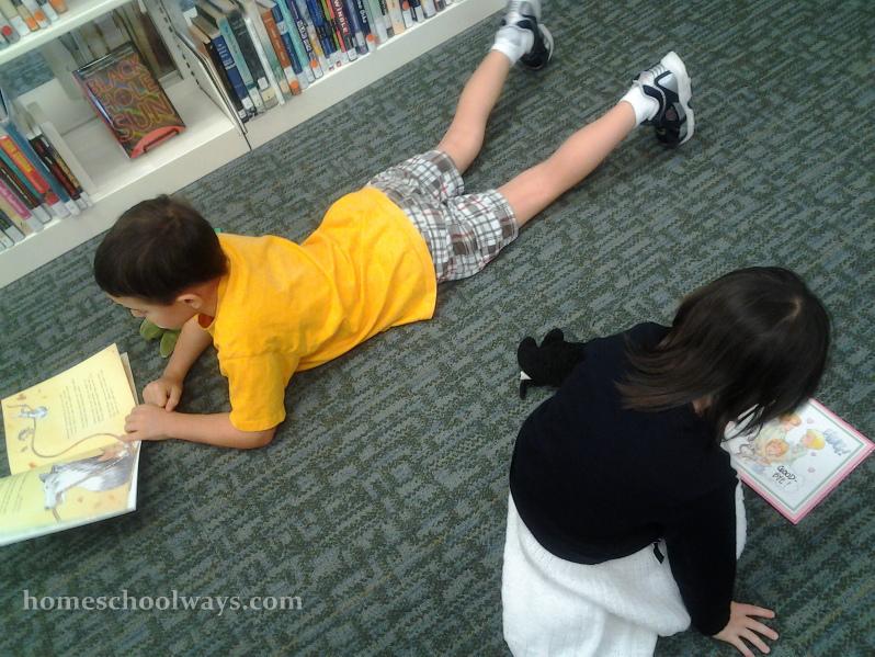 Children reading books on floor