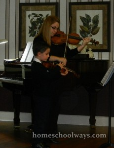My son does pizzicato for his first recital, while his teacher plays a more elaborate tune