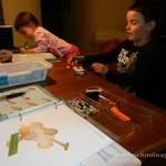 Boy builds a LEGO Education Popcorn Cart while girl works on her preschool fun