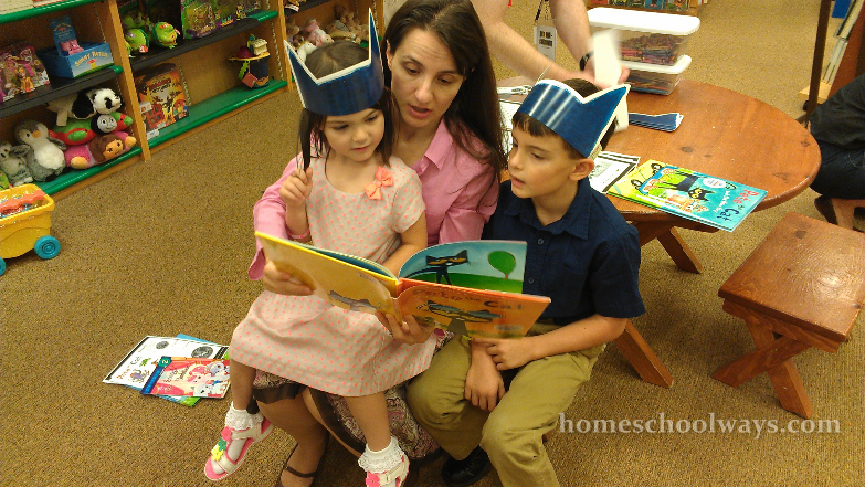 Mom reads a Pete the Cat book to her children in a bookstore