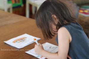 4-year-old girl solving a clue for the Clued In Kids treasure hunt