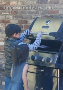 Kids finding a clue in the grill