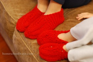Children wearing red knitted socks