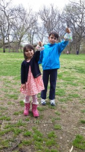 Boy and girl showing off Easter Egg Hunt Candy