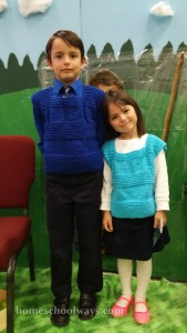 Boy and girl with knitted vests