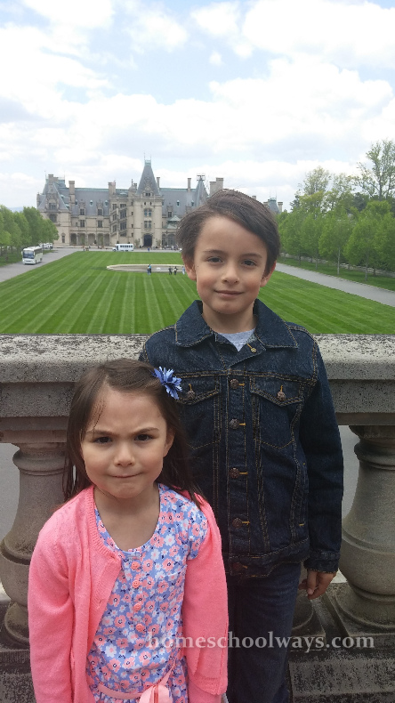 Boy and girl with the Biltmore House in the background.