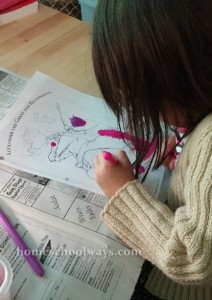 Girl coloring a picture of Alexander the Great
