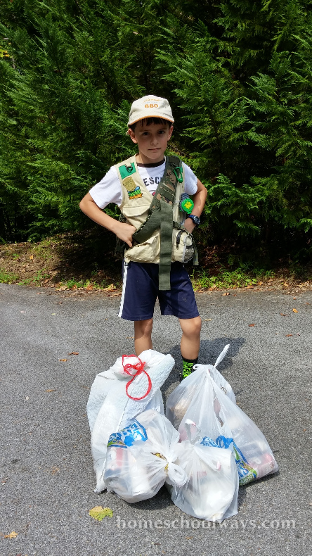 Boy with collected trash on Earth Day