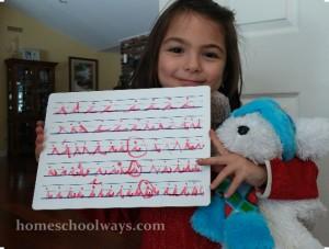 Girl holding tablet with cursive handwriting