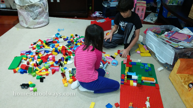 Boy and girl playing with DUPLO bricks