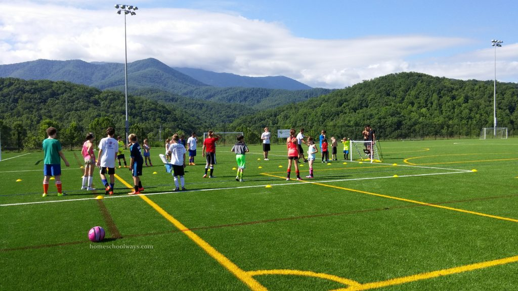 Water balloon fight at soccer camp