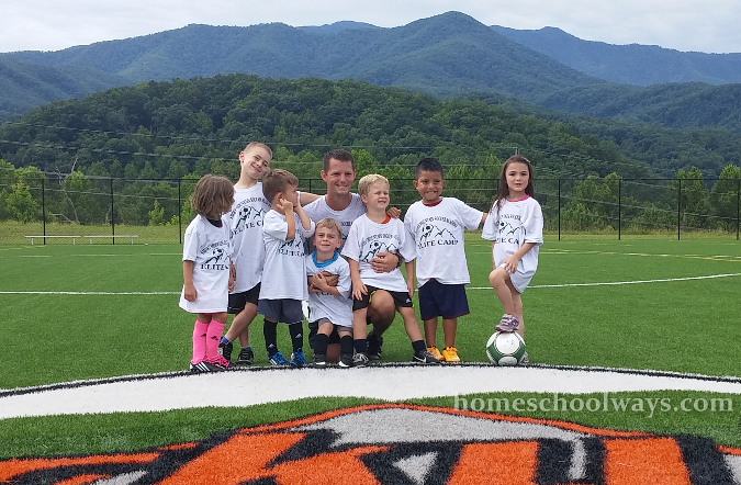 Soccer coach and young players