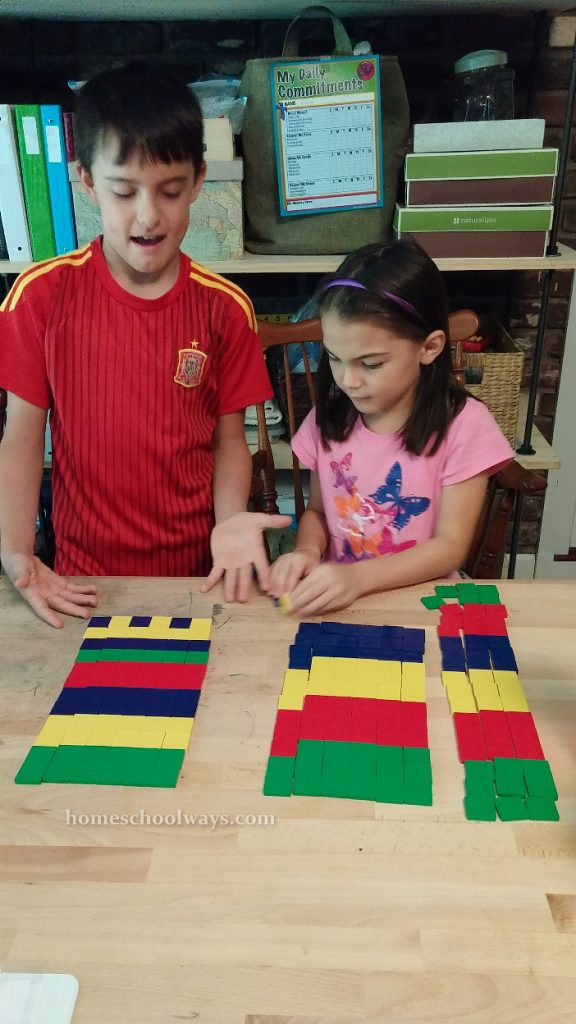 Boy and girl arranged colorful tiles in patterns
