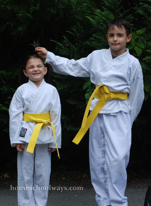 Boy and girl in tae kwon do outfits