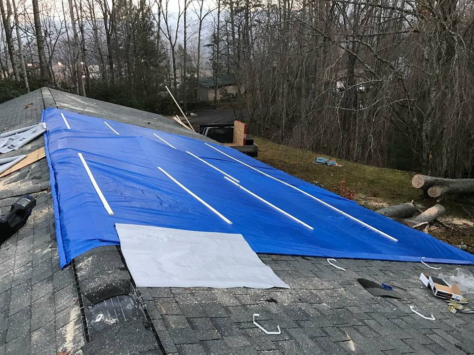 Tarp over roof