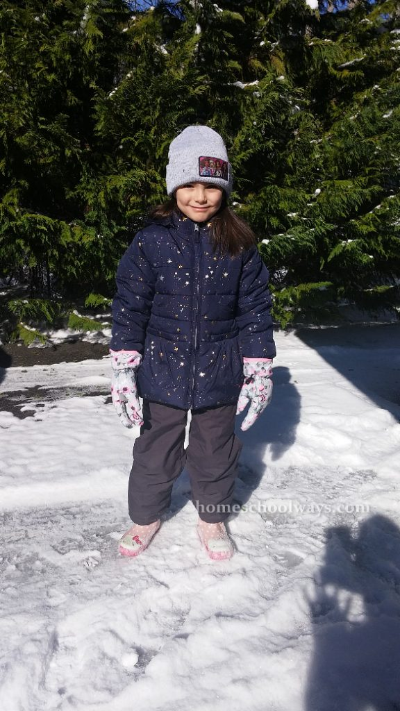 Girl dressed to play in snow