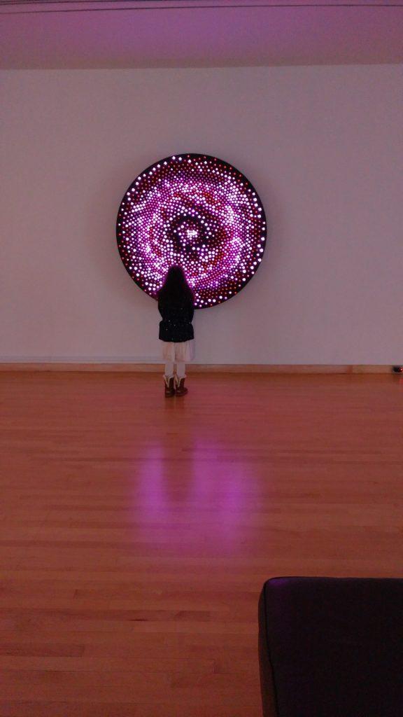 Girl looking at digital art