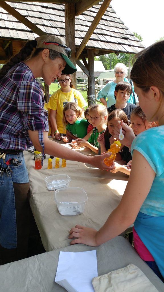 Children sample honey at the Museum of Appalachia