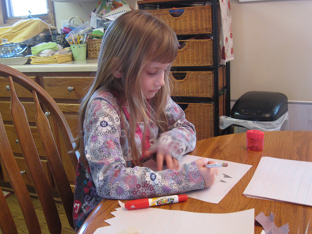 Girl homeschooling