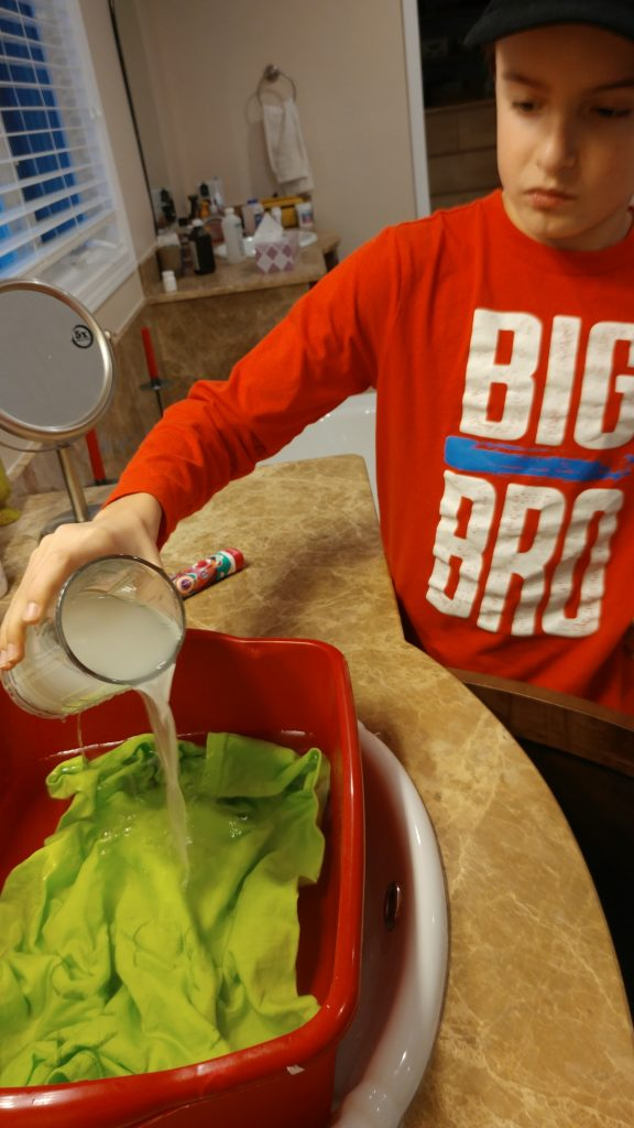 Our son pours salt over the t-shirt to set the pigment.