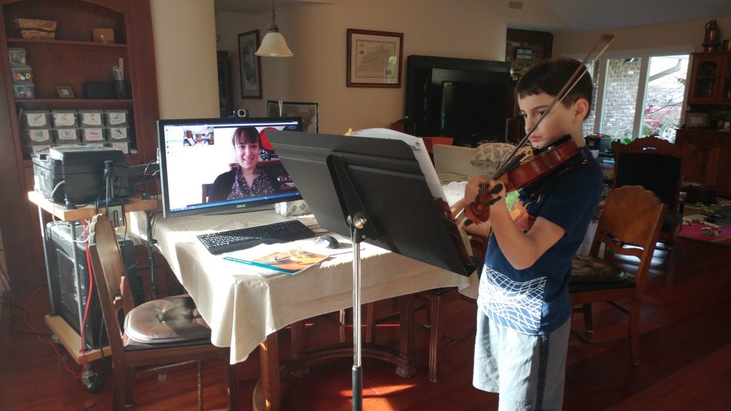 My son during his Skype violin lesson