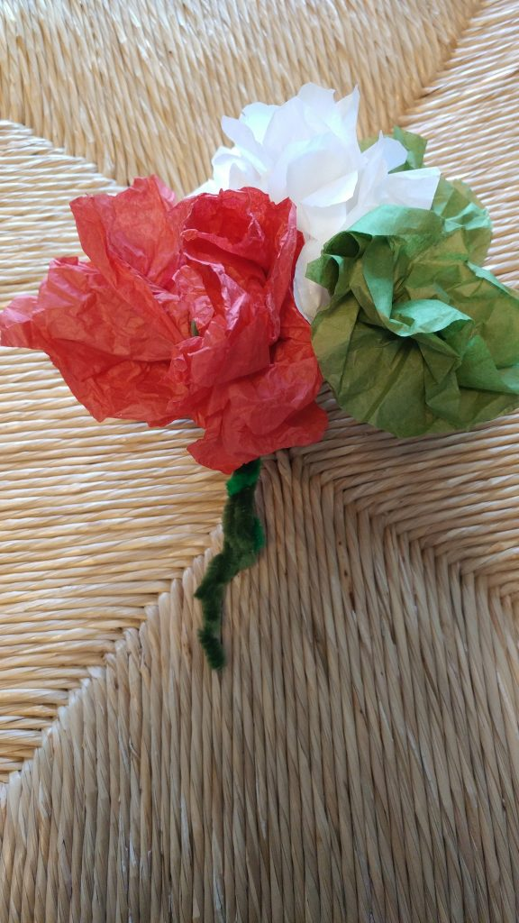 Paper flowers in the colors of the Mexican flag