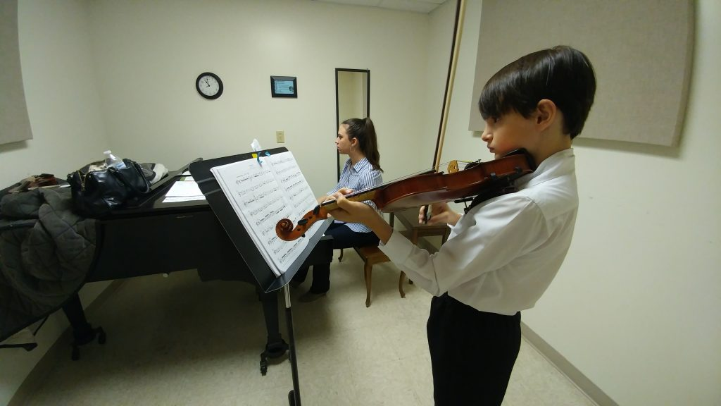 Violinist boy with pianist