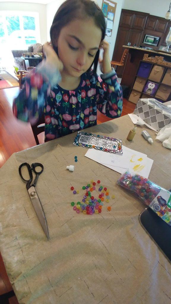 Girl makes khachkar craft