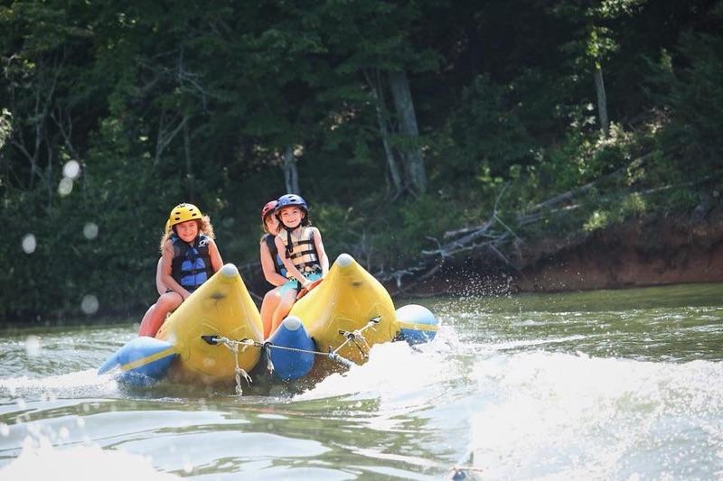 Girls riding the banana boat at Cohutta