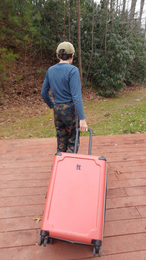 Boy carrying luggage