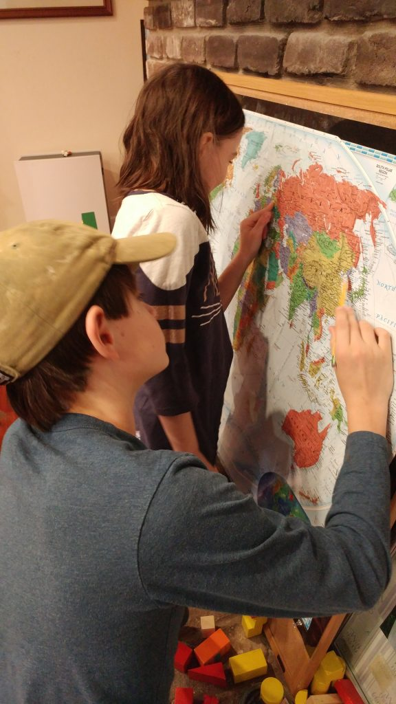 Kids looking at a world map