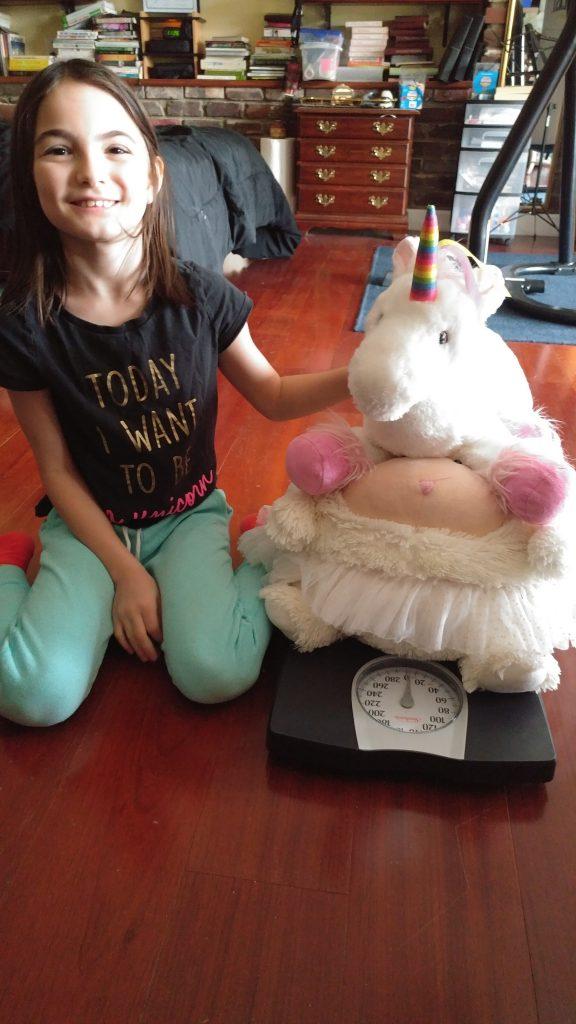 Girl weighs stuffed animals