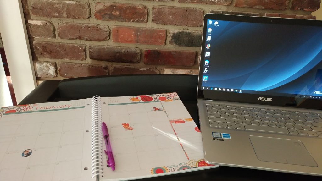 Planner and laptop