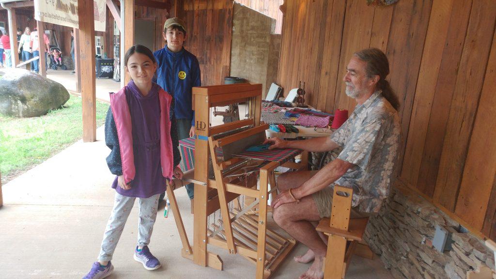 Children learn weaving