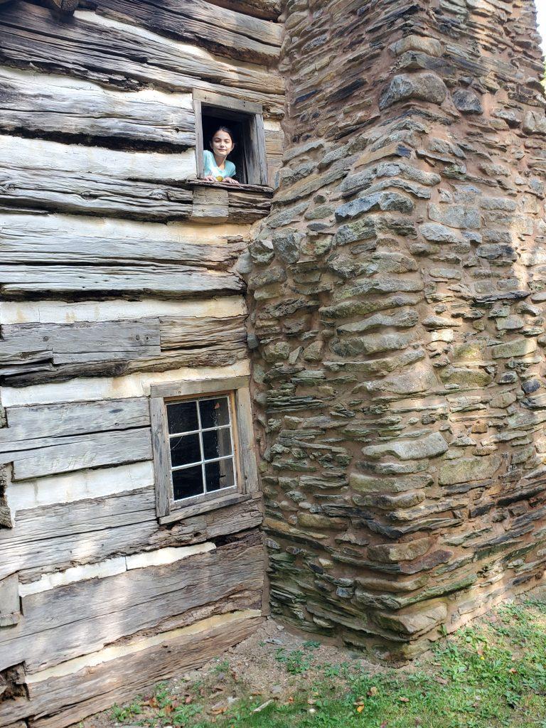 Girl peeking out of cabin