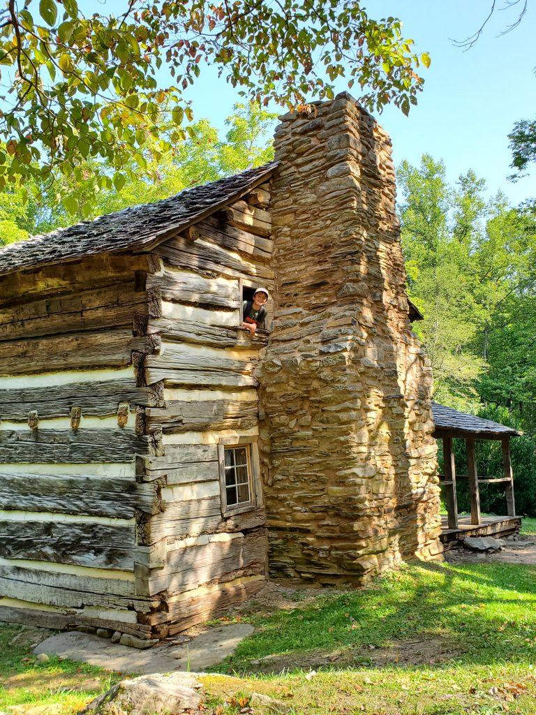 Boy peeking out of cabin