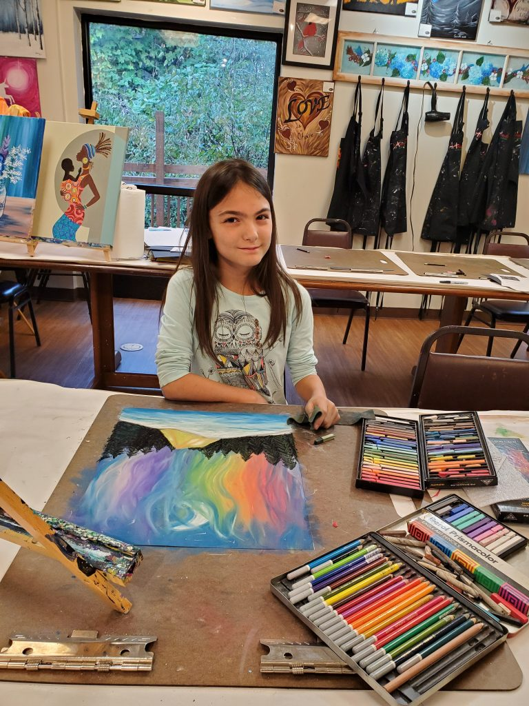 Girl doing pastel art