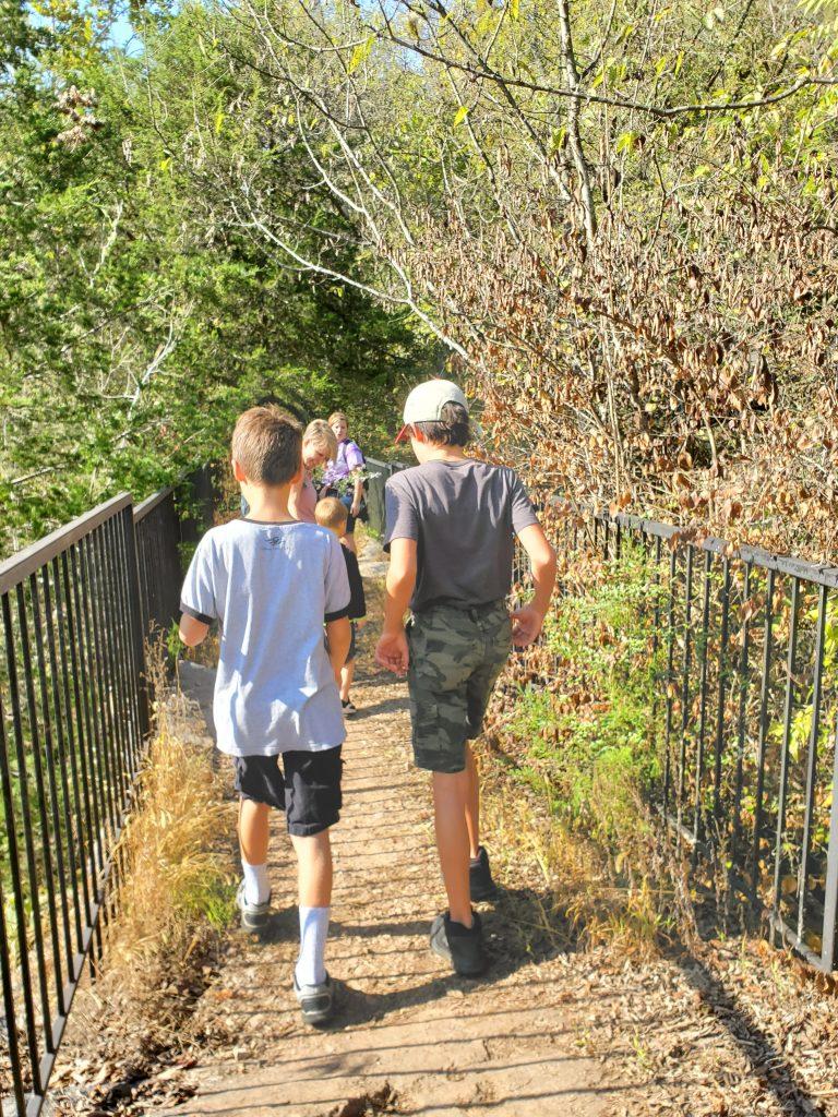 Boys talking on a trail