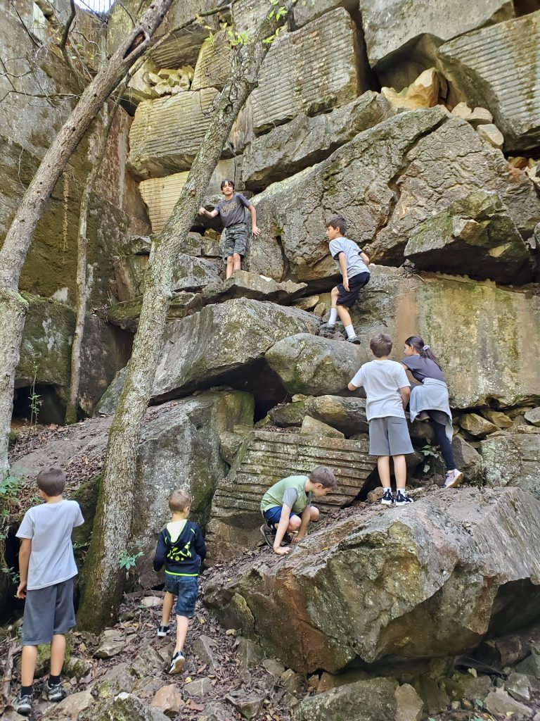 Kids scaling rocks