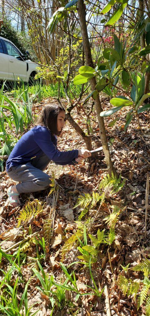 Girl working in yard