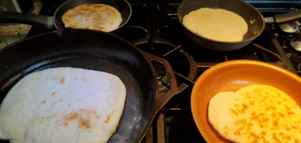Cooking flat bread in pans
