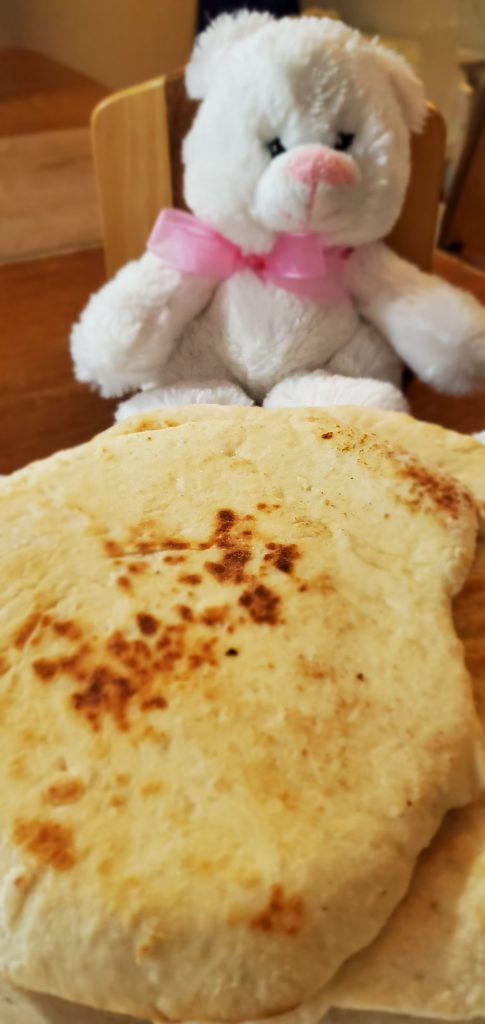Flat bread with plushie